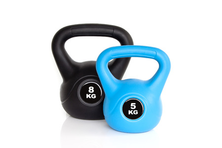 A pair of black 8 kg kettle bell and 5 kg blue kettle bell isolated on white background