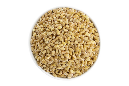 barley seeds: Pearl barley seeds in a cup from above isolated on a white background