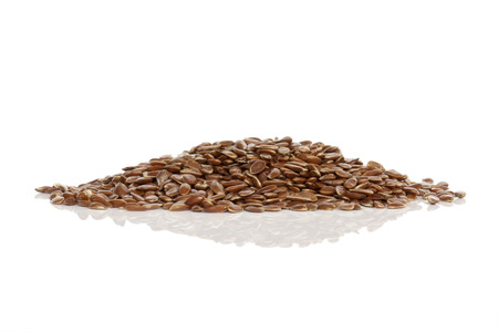 organic flax seed: Flaxseeds isolated on white background Stock Photo