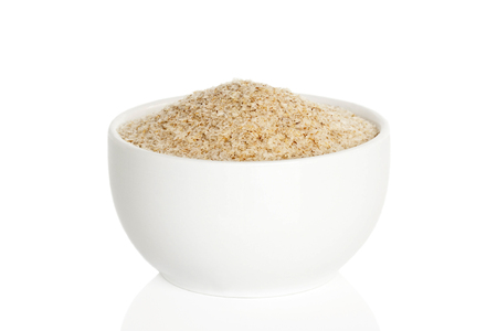 Psyllium husk in a cup isolated on white background
