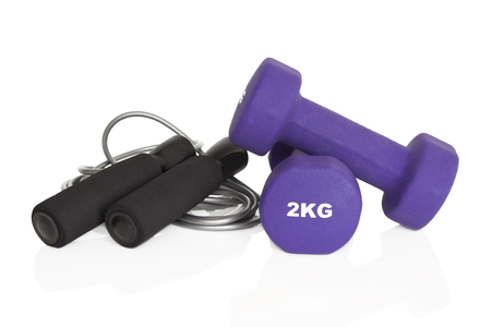 gripping bars: Dumbbells and skipping rope isolated on white background. Weights for a fitness training. Stock Photo