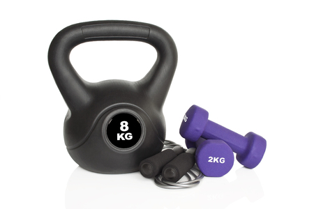 Dumbbells, kettlebell and skipping rope isolated on white background. Weights for a fitness training.