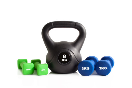 Colorful kettlebell and dumbbells for gym exercise isolated on a white background.