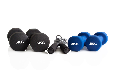 Set of dumbbells and a skipping rope isolated on a white background.