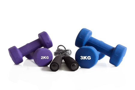Dumbbells and skipping rope white background isolation. Stok Fotoğraf