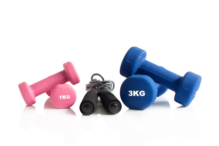 Pink and blue dumbbells with a skipping rope isolation. Stok Fotoğraf
