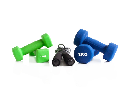 Dumbbells and skipping rope for a gym training isolated on a white background.