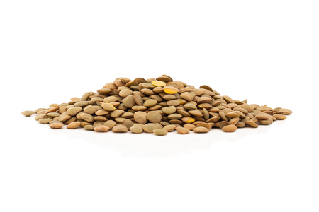 Isolated uncooked lentils on white background. Stok Fotoğraf