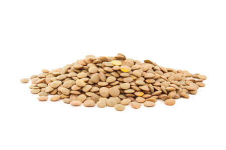 Stack of lentils isolated on white background.