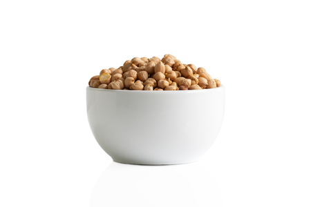 Isolated uncooked chickpeas in a cup. Stok Fotoğraf