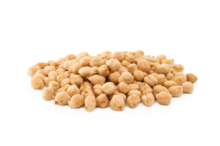 Isolated uncooked chickpeas on white background.