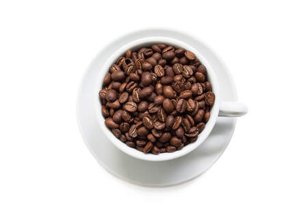 A cup of coffee beans isolated on a white background.