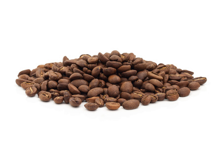 A pile of coffee beans isolated on a white background.