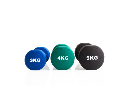 Set of dumbbells for a fitness training isolated on a white background.