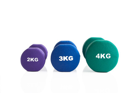 Set of fitness dumbbells for a fitness training isolated on a white background.