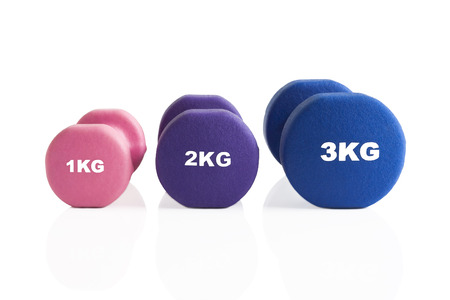 Set of gym dumbbells for a fitness training isolated on a white background Stok Fotoğraf