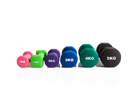A line of gym weights for training isolated on a white background.