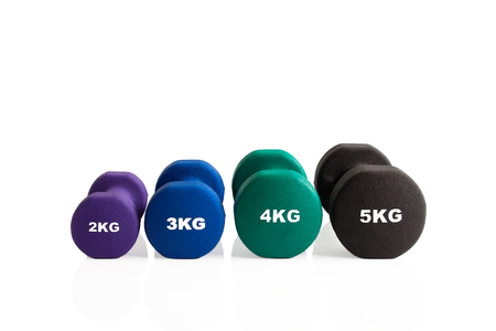 Spread of fitness dumbbells for training isolated on a white background.