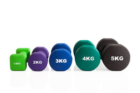 Set of colorful dumbbells isolated on a white background. Stok Fotoğraf