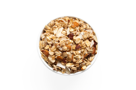 Cup of gluten-free granola isolated on a white background from above.