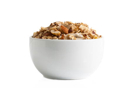 Gluten-free granola in a cup isolated on a white backgrouns.