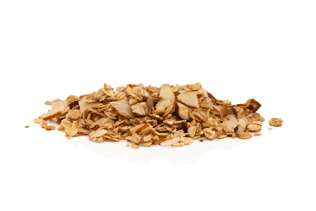 Pile of granola isolated on a white background.