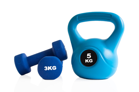 Blue kettlebell and dumbbells isolation on a white background.