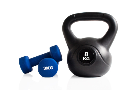 Dumbbells and kettlebell for a gym training isolated on a white background. Stok Fotoğraf