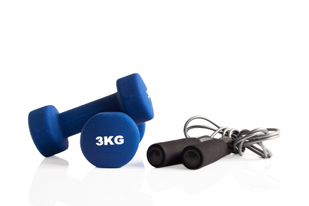 Blue 3kg dumbbells and a skipping rope for fitness training. Stok Fotoğraf