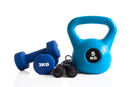 Dumbbells, kettlebell and skipping rope set for a gym training isolated on a white background. Stok Fotoğraf