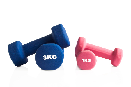 Blue and pink dumbbells for a gym training isolated on a white background.