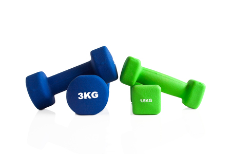 Blue and green fitness weights isolated on a white background. 스톡 콘텐츠