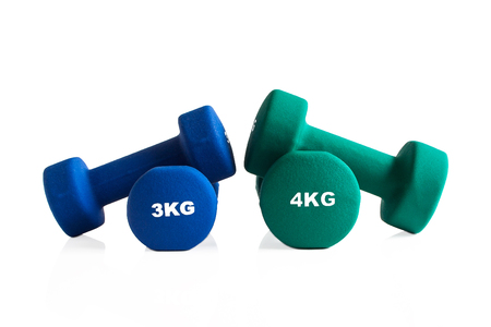 Blue and green gym dumbbells isolated on a white background.
