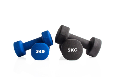 3kg and 5kg gym dumbbells isolated on a white background.
