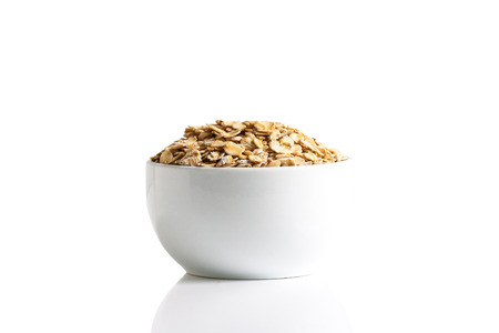 Isolation of gluten free oats in a cup on a white background. Stok Fotoğraf