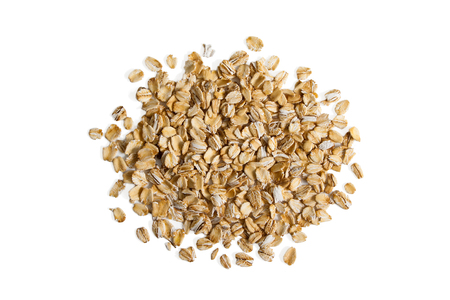 Pile of oats isolation on a white background from above.