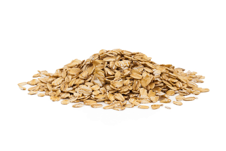 Isolated uncooked pile of oats isolated on a white background.