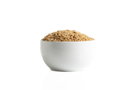 Mix of brown rice and quinoa in a cup isolated on a white background. Stok Fotoğraf