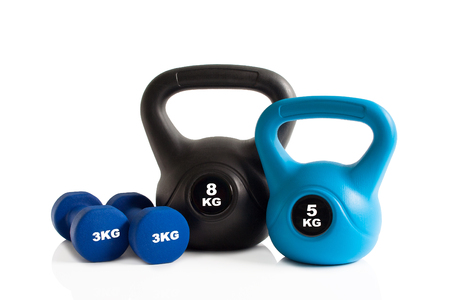 Gym kettlebells and dumbbells isolated on a white background.