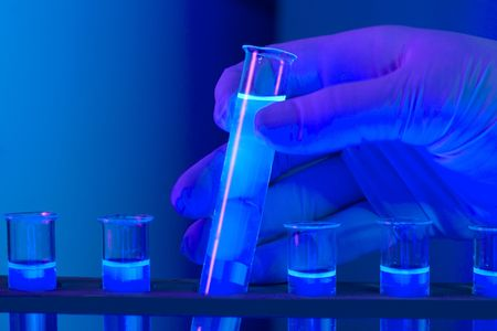 hand with test tubes blue light Stock Photo