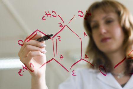 chemist writing formula Stock Photo