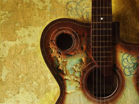 vintage grunge background with guitar on wall Stock Photo