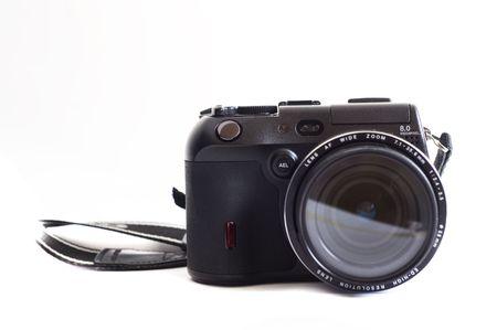 digital photo camera on white photo