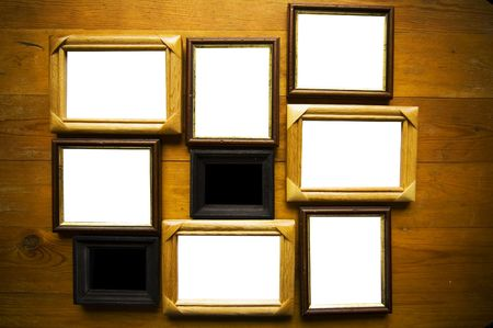 empty picture frames on wooden wall