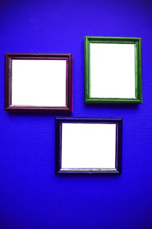 gallerie: empty frames on blue wall Stock Photo