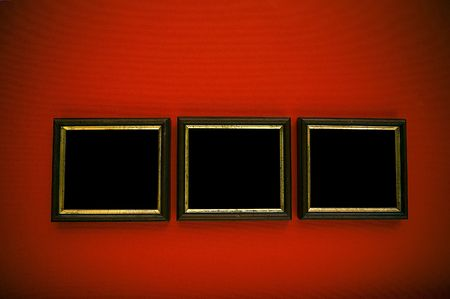 empty frames on red wall