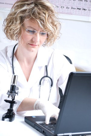 medical scientist: woman medical  scientist with microscope and stethoscope