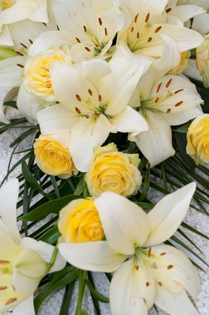 white lilies and yellow roses photo