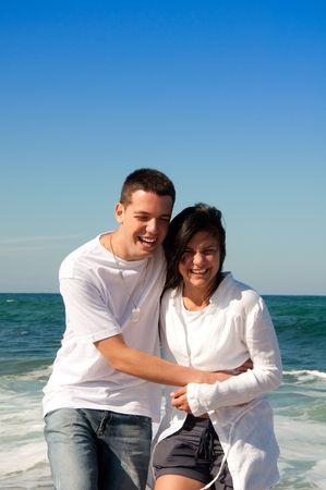 Couple having fun on the beach Stock Photo - 4951904