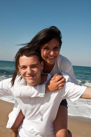 Couple having fun on the beach photo